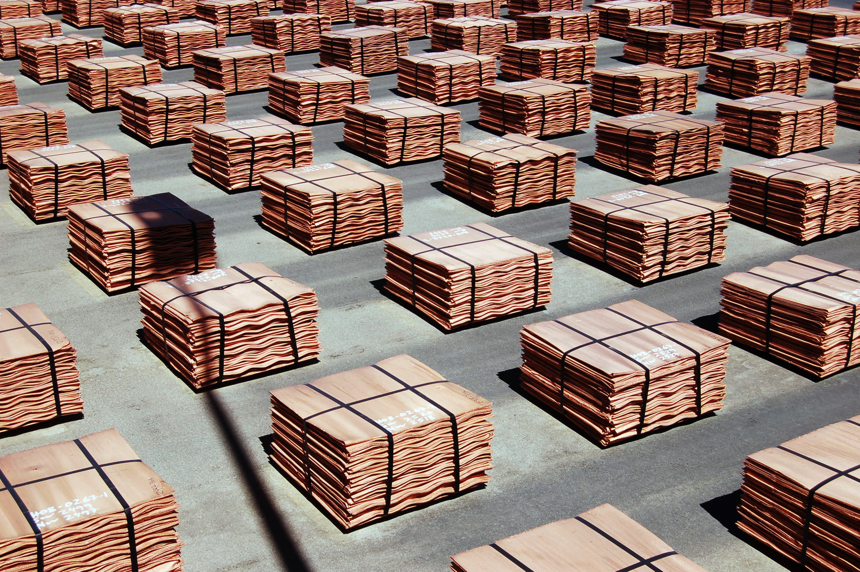 copper plate stacked in bales on a factory floor